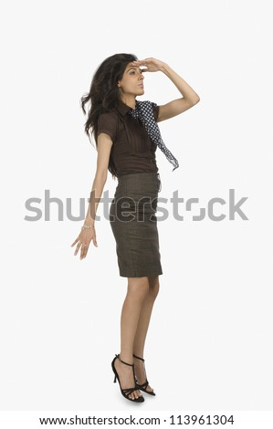 Businesswoman looking away with shielding her eyes