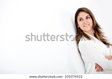 Businesswoman looking to the side over a white background #101076922