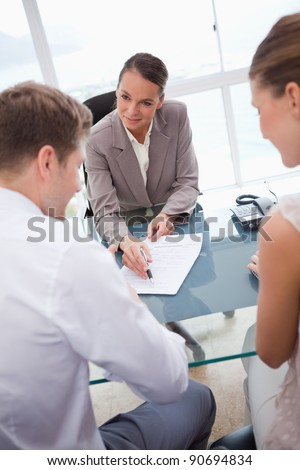 Businesswoman making an offer to negotiation partners