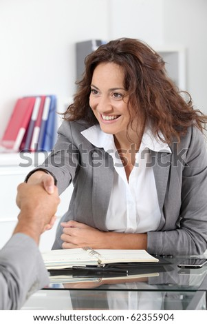 Businesswoman meeting applicant in the office
