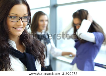 Businesswoman meeting smiley girl face on foreground
