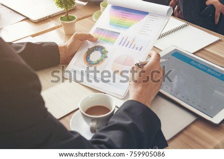 Businesswoman Monitor and Research the Financial Statements of the Company. Analyze the Feasibility of Business Prior to Mergers and Acquisitions. Analyze concept