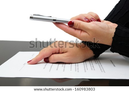 Businesswoman offering  a pen to sign a agreement