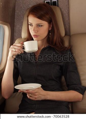 Businesswoman on a private plane.