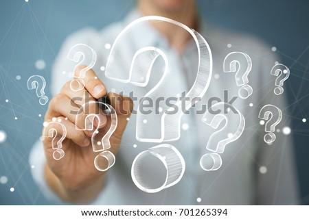 Businesswoman on blurred background drawing hand drawn question marks Stock photo ©