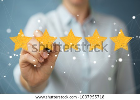 Businesswoman on blurred background rating with hand drawn stars #1037955718