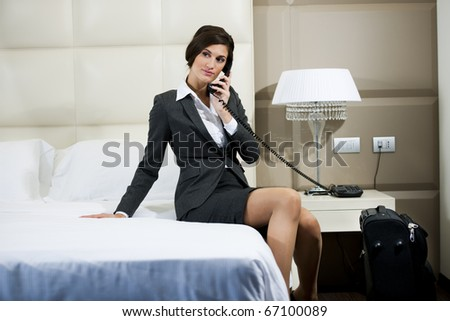 Businesswoman on the phone in hotel room