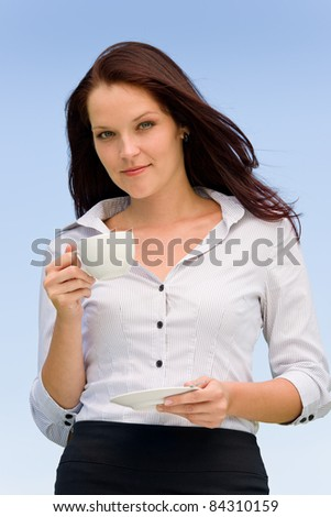 Businesswoman outdoor blue sky attractive smiling having cup of coffee