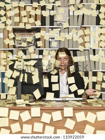 Businesswoman overloaded with reminding notes