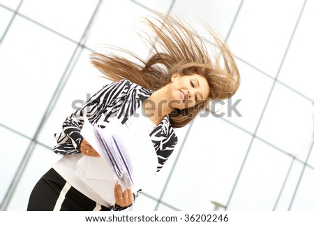 Businesswoman picks up documents