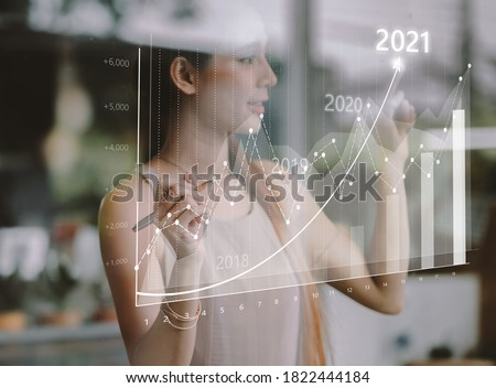 Businesswoman plan growth and increase of positive indicators in his business. Business growth concept year 2021