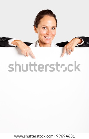 businesswoman pointing at white board - stock photo