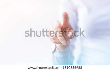 businesswoman presses on transparent touch screen. new technology Photo stock ©