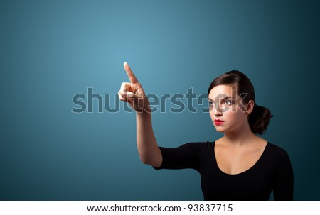 Businesswoman pressing an imaginary button, empty space for buttons