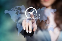 Businesswoman pressing 24/7 support service button on world map on touch screen. Customer service concept.