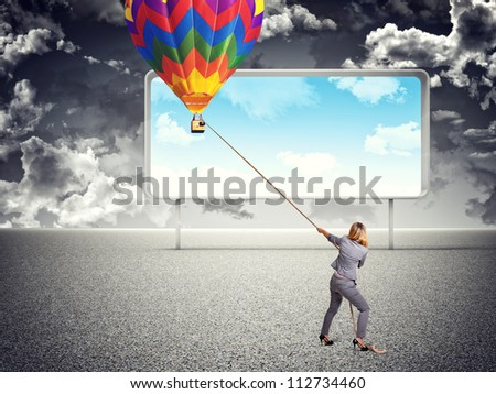 businesswoman pull hot air balloon