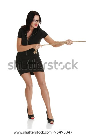Businesswoman pulling on a long piece of rope, isolated on white background