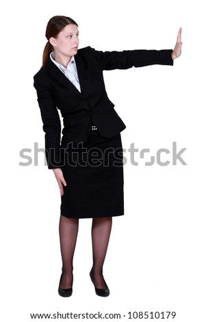 Businesswoman pushing an invisible wall