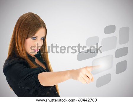 Businesswoman pushing button on screen interface.