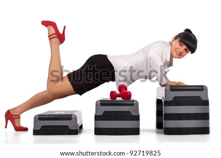 Businesswoman pushing up on steps