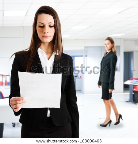 Businesswoman reading a business document