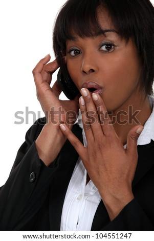 Businesswoman receiving shocking news