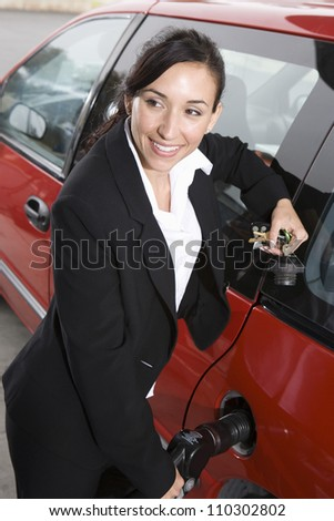 Businesswoman refueling her car