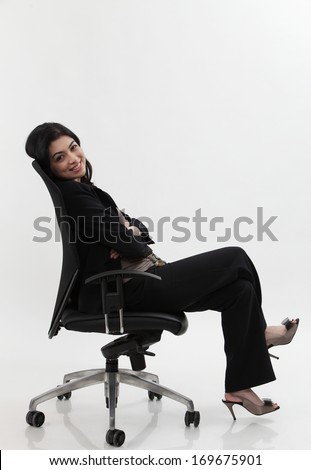 businesswoman relaxing on office chair isolated on white