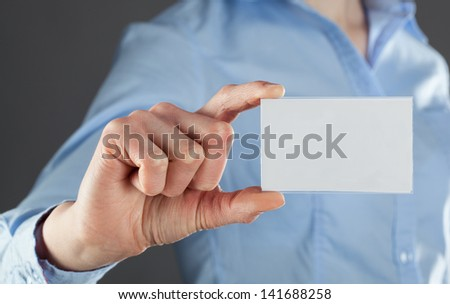 Businesswoman's hand showing business card