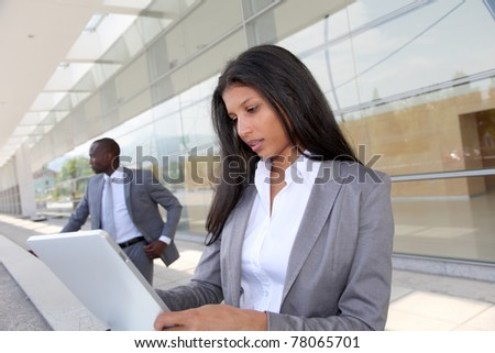Businesswoman sending email with electronic tablet
