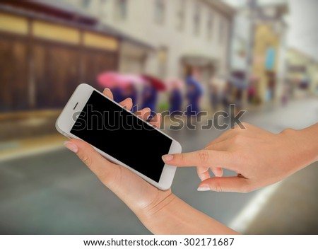 Businesswoman sending messages with her mobile phone, building Background #302171687