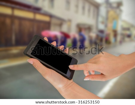Businesswoman sending messages with her mobile phone, building Background #316253150