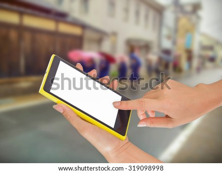 Businesswoman sending messages with her mobile phone, building Background #319098998