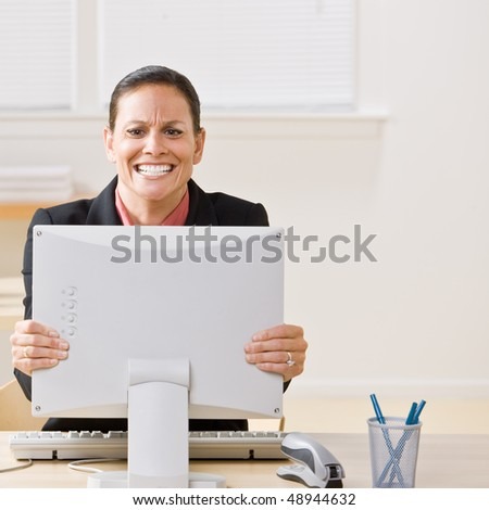 Businesswoman shaking monitor
