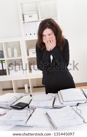 Businesswoman Shocked From Financial Documents In The Office