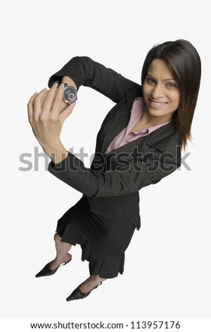 Businesswoman showing a wristwatch - stock photo