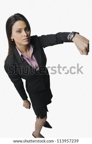 Businesswoman showing a wristwatch - stock photo