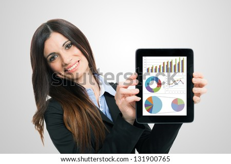 Businesswoman showing financial reports on a tablet computer