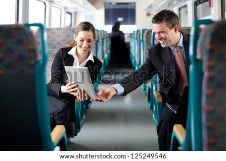 Businesswoman showing her colleague something on her tablet computer