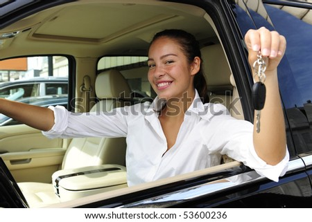 businesswoman showing keys of her new expensive  off-road vehicle