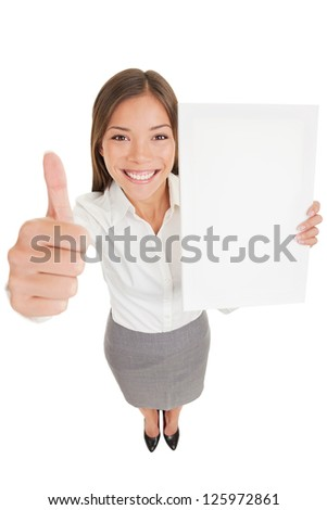 Businesswoman showing sign poster. Happy business woman giving thumb up holding an empty paperboard, with copyspace