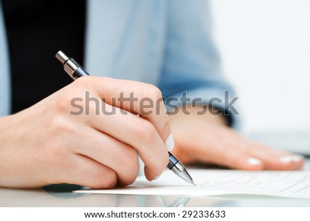 Businesswoman signing contract.