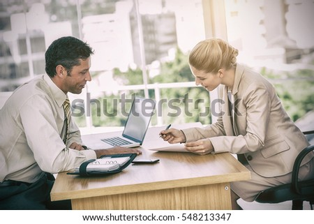 Businesswoman signing contract at interview in office #548213347