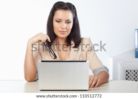 businesswoman sitting and  looking at notebook in the office