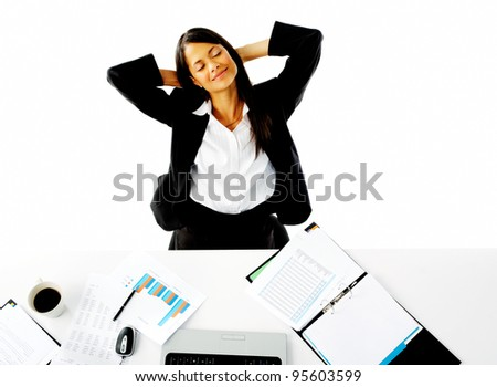 businesswoman sitting and relaxing, satisfied daydreaming at her desk. isolated on white