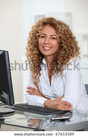 Businesswoman sitting at her desk in office
