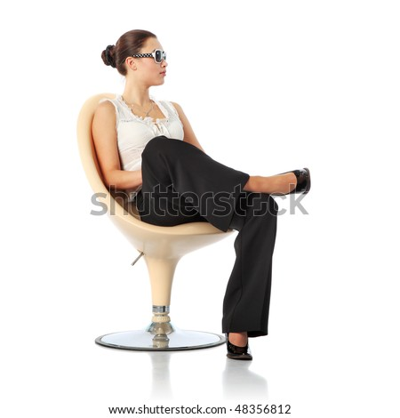 Businesswoman sitting in chair, isolated over white background