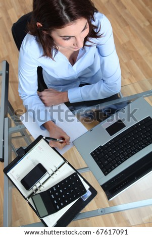 Businesswoman sitting in front of laptop computer