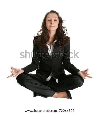 Businesswoman sitting in lotus flower position