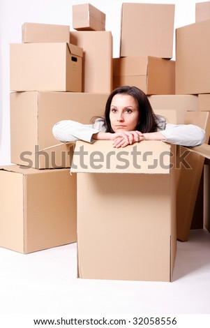 businesswoman sitting inside the box carton box background stock photo 32058556 shutterstock. Black Bedroom Furniture Sets. Home Design Ideas